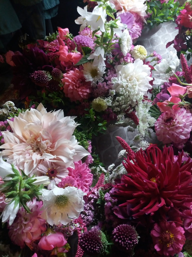 Locally grown wedding flowers for table centrepieces. Made by farmer florist. Sustainable ecofloristry